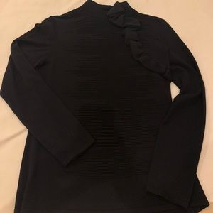 Metric Tops - Black pullover top with embellishment on front.